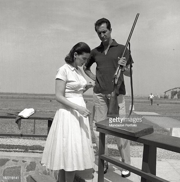 The actress Lucia Bosè and her bullfighter husband Luis Miguel Dominguin are at a shooting range Venice 1956