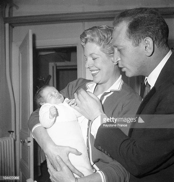 The Actress Madeleine Robinson And JeanLouis Jaubert The Leader Of Les Compagnons De La Chanson Proudly Display Their Newborn Daughter SophieJulia On...
