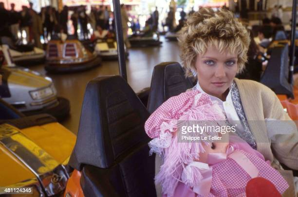 The actress Mimi Cutler in a carousel at the Foire du Trone in Paris in 1988