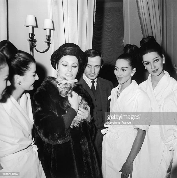 The Actress Sophia Loren And The Fashion Designer Marc Bohan Surrounded By Models From The Christian Dior Fashion House After The Presentation Of The...