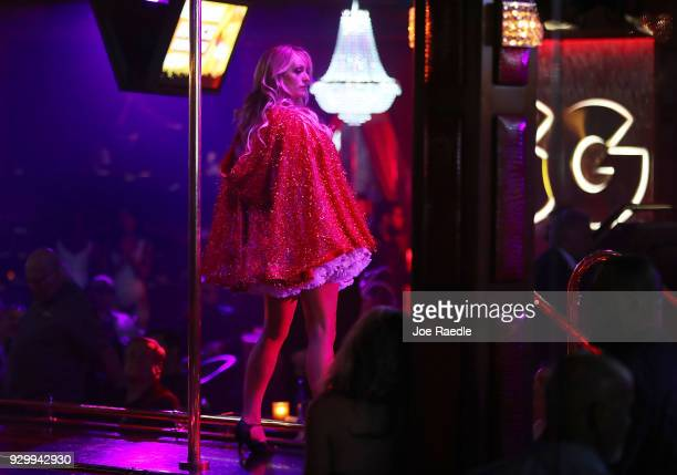 The actress Stephanie Clifford who uses the stage name Stormy Daniels performs at the Solid Gold Fort Lauderdale strip club on March 9 2018 in...