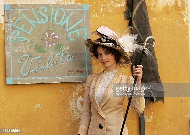 The actress Violante Placido posing on the set of the TV miniseries Il furto della Gioconda The actress posing beside the sign of the Pensione...