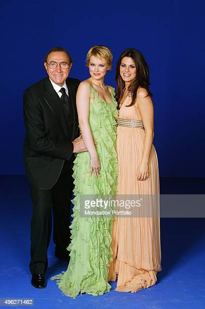 The actresses Bianca Guaccero and Andrea Osvart presenting with the host Pippo Baudo the 58th Sanremo Music Festival. Italy, 2008