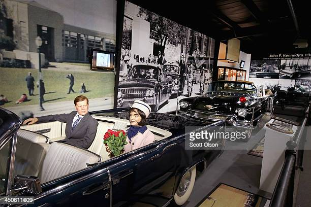 The actual Secret Service car which followed President John F Kennedy's limousine when he was shot and killed in Dallas is displayed behind a Lincoln...