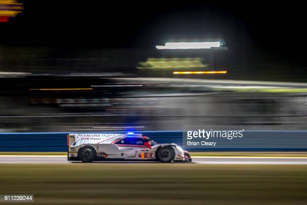 The Acura DPi of Dane Cameron Juan Pablo Montoya of Colombia and Simon Pagenaud of France races on the track at night during the Rolex 24 at Daytona...