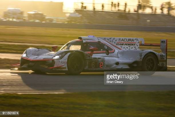 The Acura DPi of Dane Cameron Juan Pablo Montoya of Colombia and Simon Pagenaud of France races on the track during the Rolex 24 at Daytona IMSA...