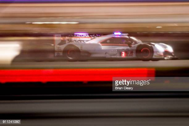 The Acura DPi of Ricky Taylor Helio Castroneves of Brazil and Graham Rahal races on the track at night during the Rolex 24 at Daytona at Daytona...