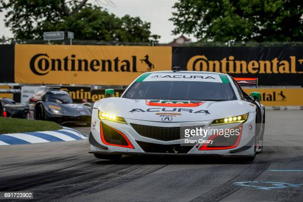 The Acura NSX GT3 of Katherine Legge of Great Britain and Andy Lally races on the track during practice for the Detroit Grand Prix IMSA WaetherTech...