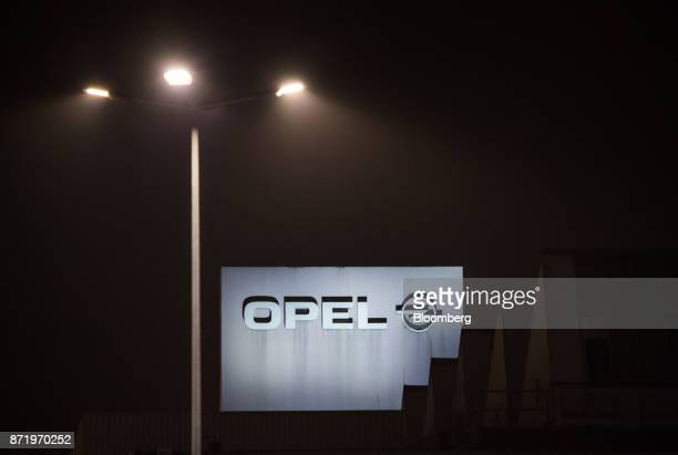 The Adam Opel AG logo sits illuminated outside the Opel automobile factory in Ruesselsheim Germany on Thursday Nov 9 2017 PSA Group will offer...
