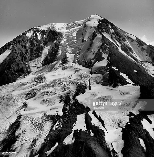 The Adams and Pinnacle glaciers occupy the northwestern slopes of Mount Adams. The crumbling snowpack on the mountain's peak feeds both these...