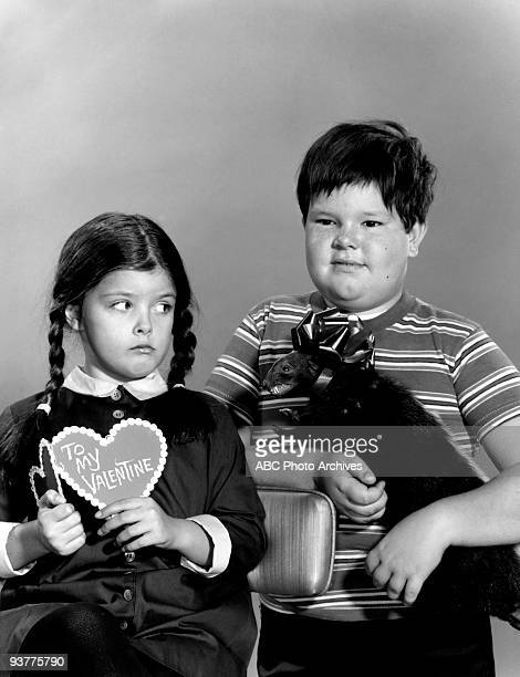The Addams Family Adams Family Gallery Season One Wednesday poses holding a valentine with her Brother Pugsley holding a Taxidermied animal