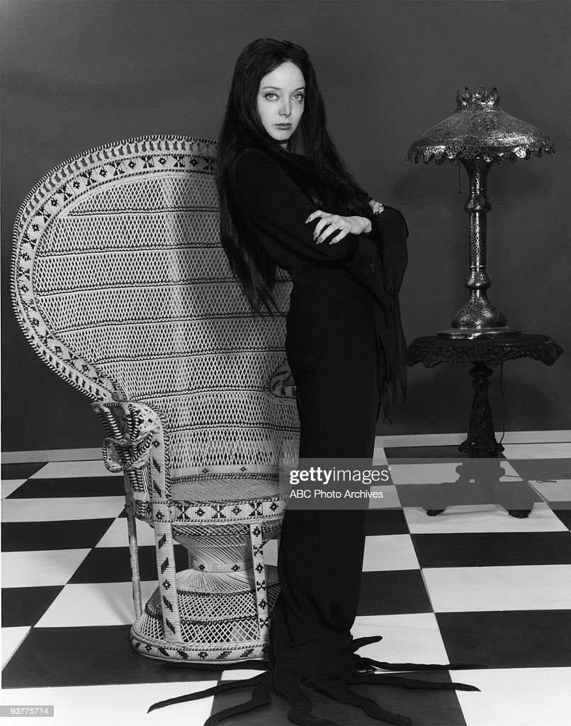 The Addams Family - 'Carolyn Jones Gallery' Season 1., Morticia ( Carolyn Jones ) Stands with arms crossed looking torwards viewer.,