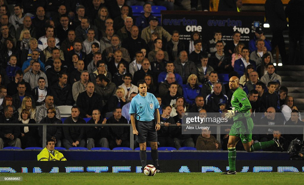 The Additional Assistant Referee keeps an eye on Tim Howard of Everton from behind the goal line during the UEFA Europa League Group I match between Everton and AEK Athens at Goodison Park on September 17, 2009 in Liverpool, England.