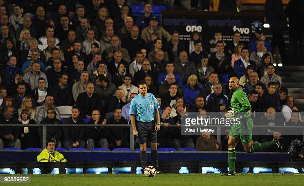 The Additional Assistant Referee keeps an eye on Tim Howard of Everton from behind the goal line during the UEFA Europa League Group I match between...