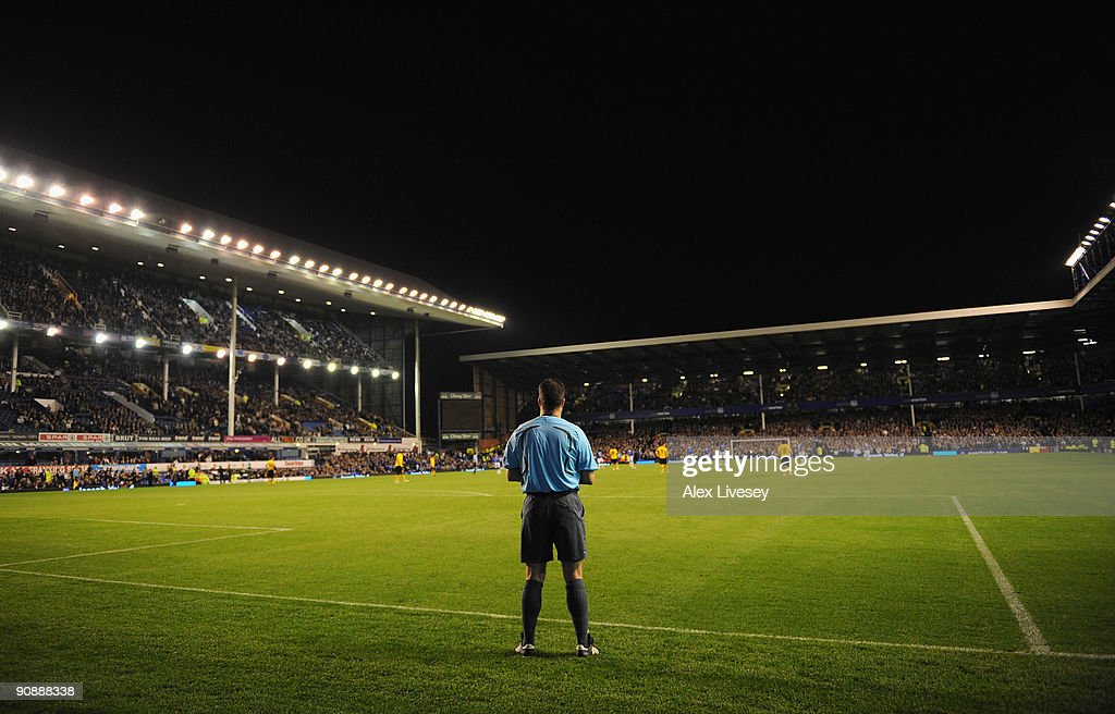 The Additional Assistant Referee watches the action from behind the goal line during the UEFA Europa League Group I match between Everton and AEK Athens at Goodison Park on September 17, 2009 in Liverpool, England.