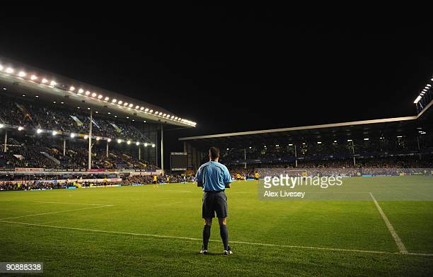 The Additional Assistant Referee watches the action from behind the goal line during the UEFA Europa League Group I match between Everton and AEK...