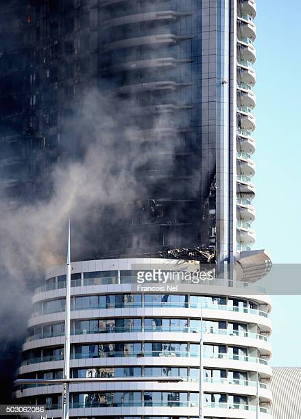 The Address Downtown Hotel is surrounded by smoke early on January 1 2016 in Dubai United Arab Emirates At least 16 people were injured after a large...