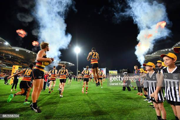 The Adelaide Crows players run out onto the field during the round eight AFL match between the Adelaide Crows and the Melbourne Demons at Adelaide...