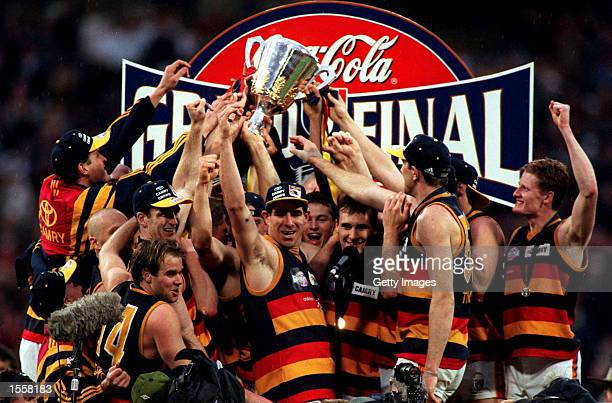 The Adelaide Crows team celebrates their victory over the Kangaroos in the 1997 AFL Grand Final at the MCG in Melbourne Australia Mandatory Credit...