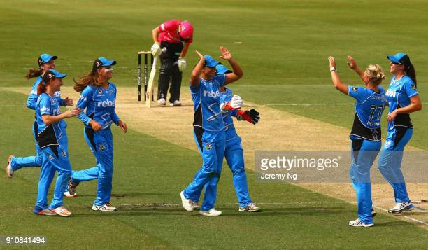 The Adelaide Strikers celebrate a runout of Ashleigh Gardner of the Sixers during the Women's Big Bash League match between the Adelaide Strikers and...