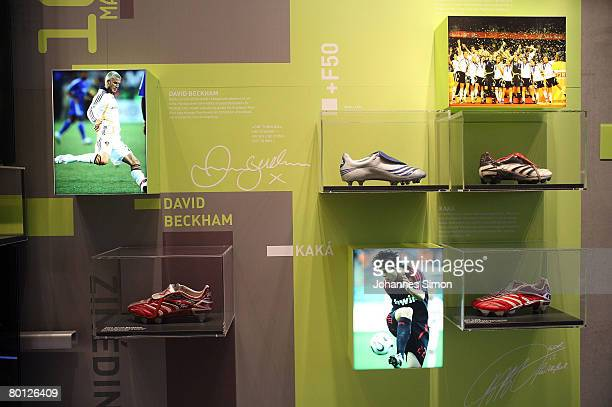 The Adidas boots of soccer stars David Beckham and Kaka are seen in a showcase during the announcement of the results 2007 of the sporting goods...
