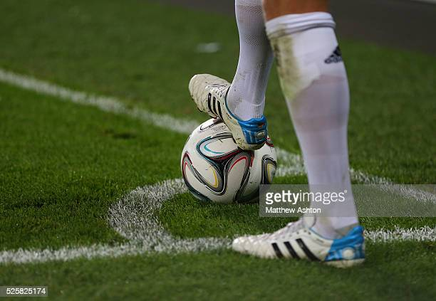 The Adidas boots of Toni Kroos of Real Madrid rests on the ball