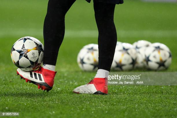 The Adidas Champions League Road To Kiev match ball is seen with a pair of Adidas Predator football boots during the UEFA Champions League Round of...