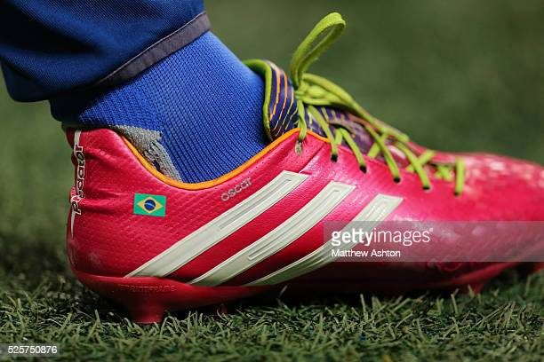 The Adidas football boots of Oscar of Chelsea with a flag of Brazil on his Predator boots