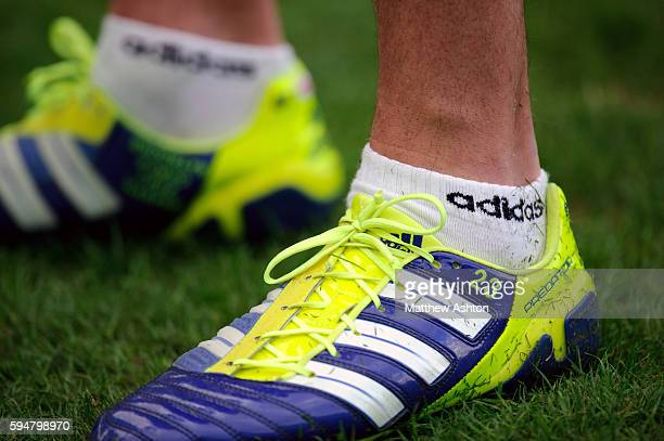 The Adidas Predator football boots of David Beckham of Los Angeles Galaxy with the names of his children Brooklyn Romeo Cruz and Harper stitched into...