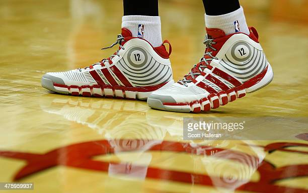 The Adidas shoes of Dwight Howard of the Houston Rockets are seen during the game against the Detroit Pistons at the Toyota Center on March 1 2014 in...