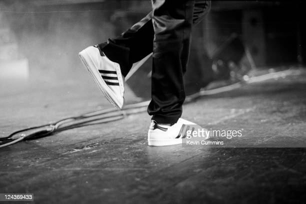 The Adidas trainers of a member of hip hop group Run DMC as they perform on stage at Manchester Apollo, 25th May 1987.