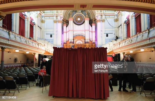 The Adjudicators' Box is shrouded in red curtains to ensure the two adjudicator's are not able to see the performing bands to guarantee fairness in...