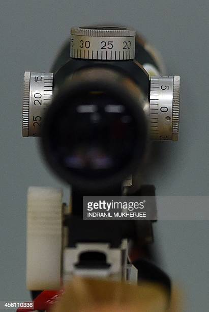 The adjustment knobs of China's Su Li's rifle scope are seen during a rest in the women's 10m running target event of the 2014 Asian Games at the...