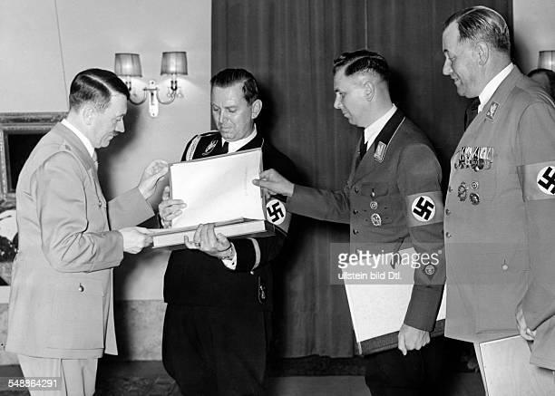 The adjutants congratulating Adolf Hitler from right William Brueckner Albert Bormann Julius Schaub Photographer PresseIllustrationen Heinrich...