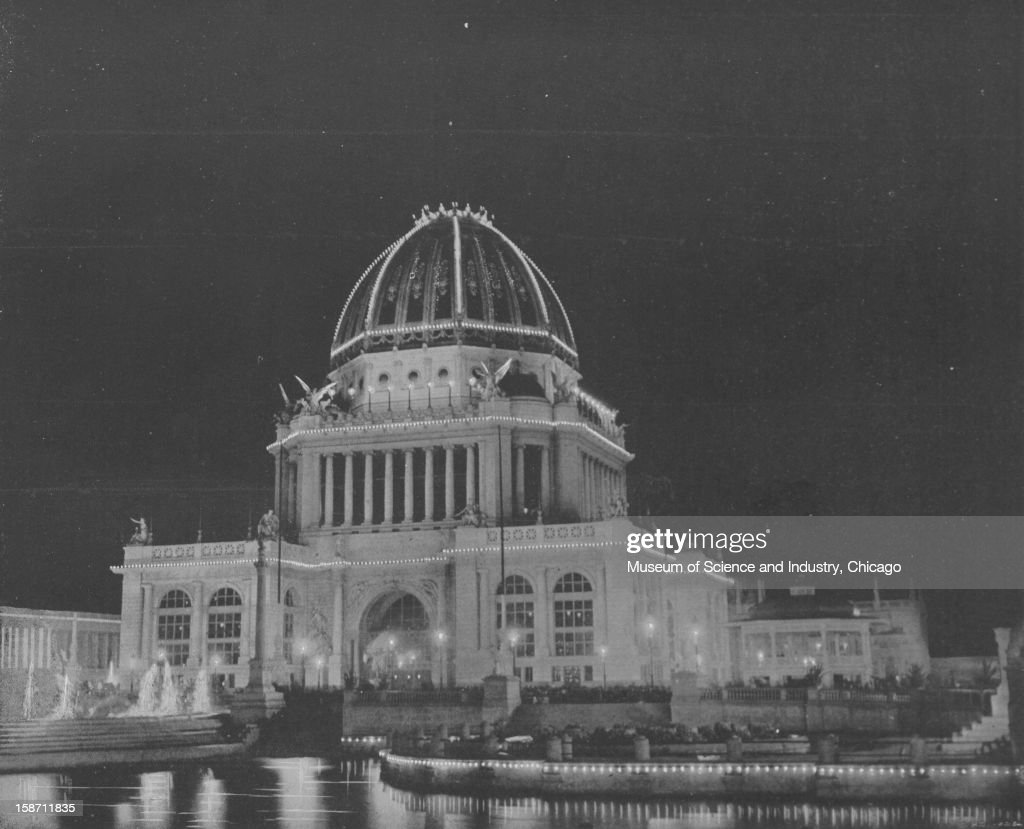 The Administration Building Illuminated at night at the World's Columbian Exposition in Chicago, Illinois, 1893. This image was published in 'The Dream City-World's Fair Art Series 5' by N. D. Thompson Publishing Company, 1893.