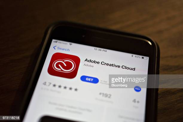 The Adobe Systems Inc Creative Cloud application is displayed in the App Store on an Apple Inc iPhone in an arranged photograph taken in Tiskilwa...