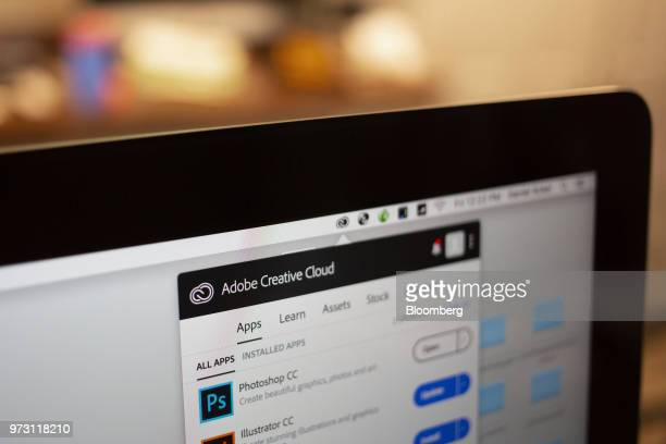 The Adobe Systems Inc Creative Cloud application manager window is displayed on a computer monitor in an arranged photograph taken in Tiskilwa...