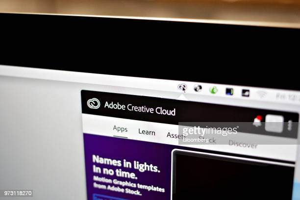 The Adobe Systems Inc Creative Cloud software application manager window is displayed on a computer monitor in an arranged photograph taken in...
