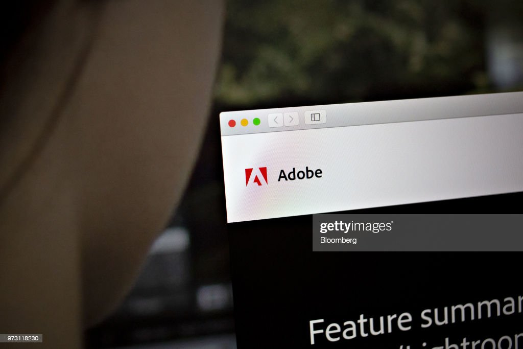 The Adobe Systems Inc. logo is displayed on a computer monitor in an arranged photograph taken in Tiskilwa, Illinois, U.S., on Friday, June 8, 2018. Adobe Systems Inc. is scheduled to release earnings figures on June 14. Photographer: Daniel Acker/Bloomberg via Getty Images