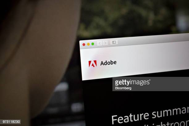 The Adobe Systems Inc logo is displayed on a computer monitor in an arranged photograph taken in Tiskilwa Illinois US on Friday June 8 2018 Adobe...