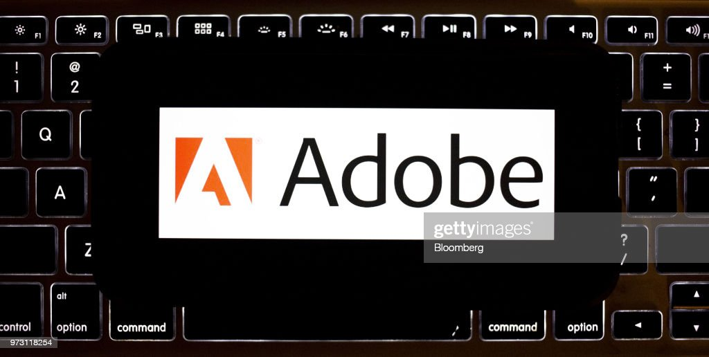 The Adobe Systems Inc. logo is displayed on an Apple Inc. iPhone in an arranged photograph taken in Tiskilwa, Illinois, U.S., on Friday, June 8, 2018. Adobe Systems Inc. is scheduled to release earnings figures on June 14. Photographer: Daniel Acker/Bloomberg via Getty Images