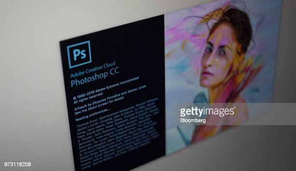 The Adobe Systems Inc Photoshop CC software startup screen is displayed on a computer monitor in an arranged photograph taken in Tiskilwa Illinois US...