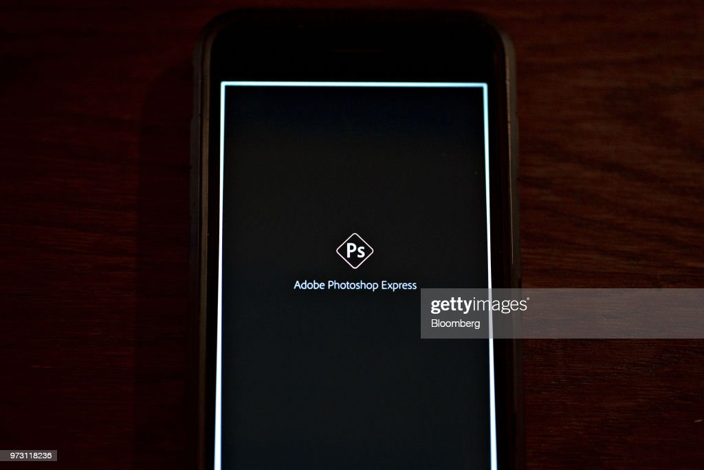 The Adobe Systems Inc. Photoshop Express application start-up screen is displayed on an Apple Inc. iPhone in an arranged photograph taken in Tiskilwa, Illinois, U.S., on Friday, June 8, 2018. Adobe Systems Inc. is scheduled to release earnings figures on June 14. Photographer: Daniel Acker/Bloomberg via Getty Images