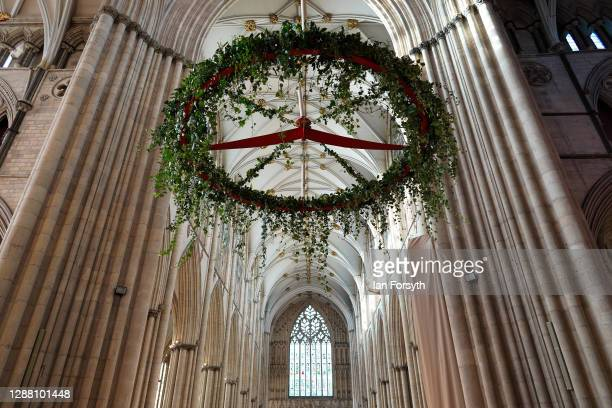 The Advent wreath is raised into its traditional position below the central tower at York Minster on November 27, 2020 in York, England. At 4 metres...