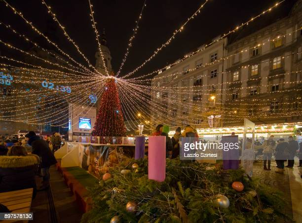 The advent wreath of the Christmas Market in front of the St Stephen's Basilica is seen at Szent István tér on December 19 2017 in Budapest Hungary
