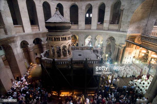 The Aedicule inside the church of the holy Sepulchre in Jerusalem. Roman Catholic Easter Sunday prayers on the right and Orthodox ceremony on the...