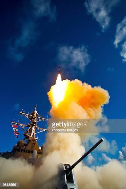 The Aegis-class destroyer USS Hopper launching a standard missile 3 Blk IA in Kauai, Hawaii.