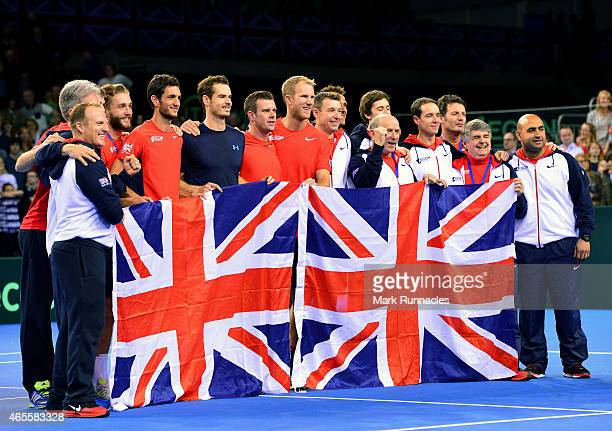 The Aegon GB Davis Cup Team celebrate their victory over the USA on Day 3 of the Davis Cup match between GB and USA at the Emirates Arena on March 8...