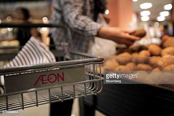 The Aeon Co logo is displayed on a shopping cart at the retailer's mall in the Long Bien district of Hanoi Vietnam on Thursday July 21 2016 With a...
