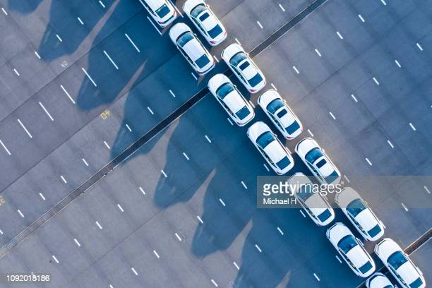 the aerial photograph of the outdoor warehouse of the new car. - motor vehicle stock pictures, royalty-free photos & images